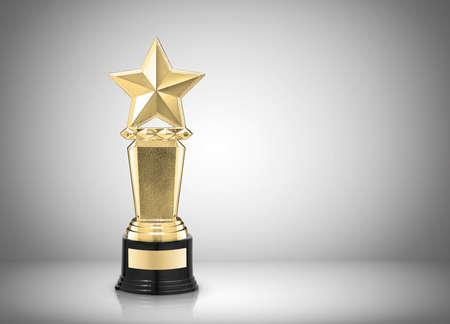premios: Premio Estrella de oro sobre fondo gris Foto de archivo