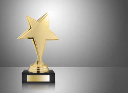 Golden star trophy on gray background