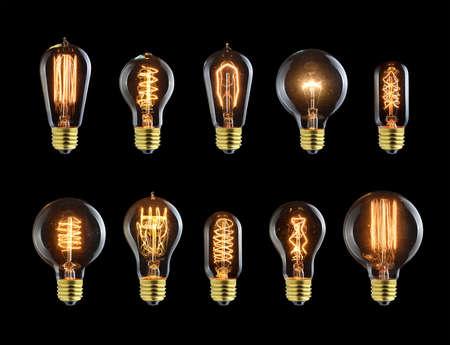 Set of vintage glowing light bulbs on black