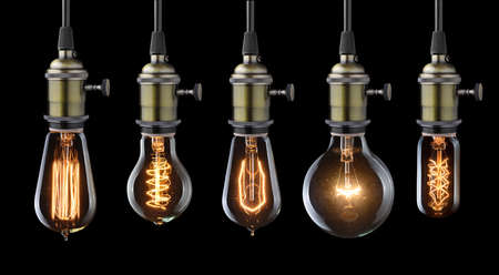 light bulb idea: Set of vintage glowing light bulbs on black