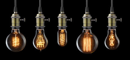 white light: Set of vintage glowing light bulbs on black