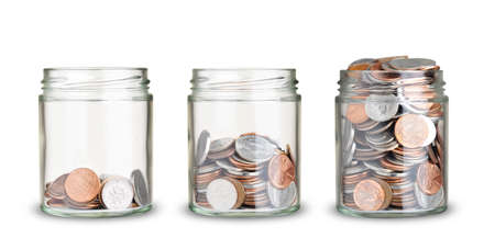jars with different level of coins isolated on white Foto de archivo