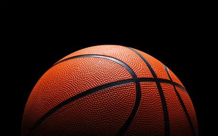 basketball shot: Basketball against black