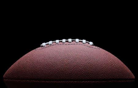 American football op zwarte achtergrond Stockfoto