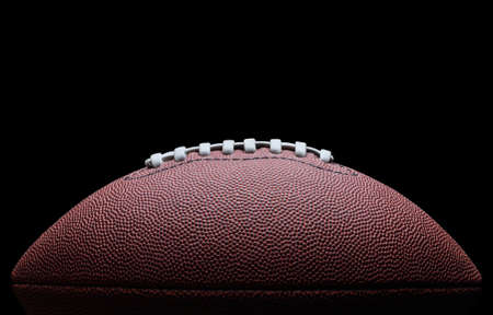 black leather texture: American football over black background