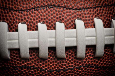 canadian football: American football close up with laces and texture