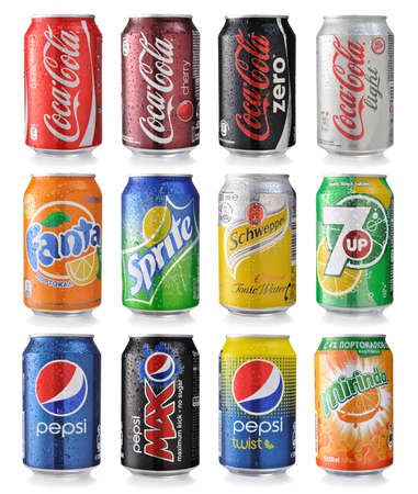 SOFIA, BULGARIA - MAY 23, 2014 Collection of various brands of soda drinks in aluminum cans isolated on white. Brands included in this group are Coca Cola, Pepsi, Sprite, Fanta, 7up, Mirinda, Schweppes