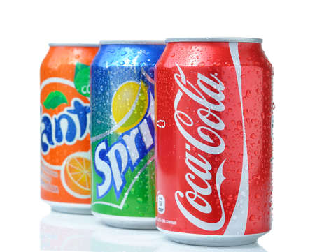 SOFIA, BULGARIA - APRIL 27, 2013: Coca-Cola, Fanta and Sprite Cans Isolated On White. The three drinks produced by the Coca-Cola Company 新闻类图片