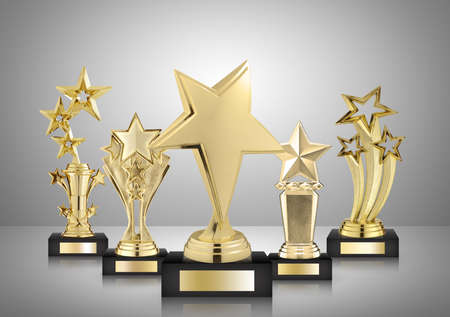 gold star trophies on gray background 版權商用圖片