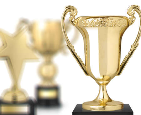first place: golden trophies isolated on white background