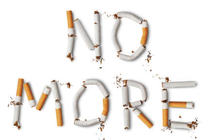 Text NO MORE made from broken cigarettes Stock Photo