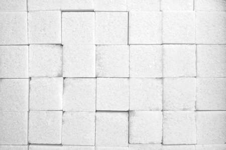 sweetening: white sugar in cubes texture background Stock Photo