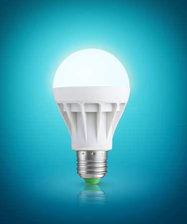 e27: Glowinng LED bulb on blue background
