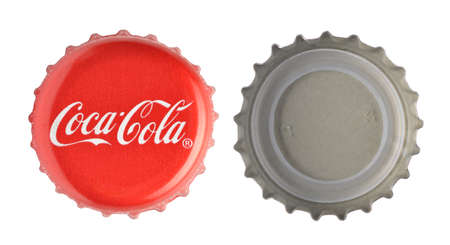 bottle cap: LOS ANGELES , USA - NOVEMBER 11, 2014: Coca-Cola classic cap on white background. Coca-cola is the Worlds most selling carbonated soft drink Editorial