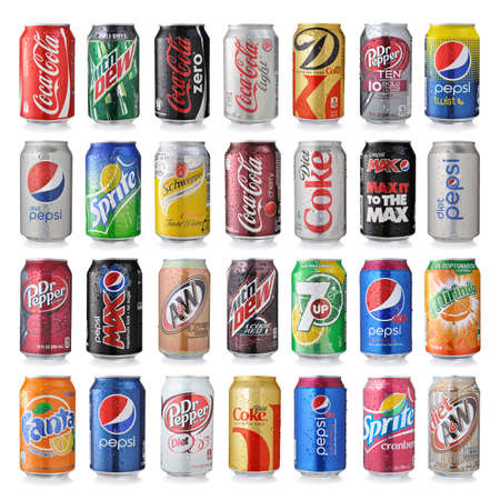 soda: LOS ANGELES, USA - DECEMBER 22, 2014 Collection of various brands of soda drinks in aluminum cans isolated on white.