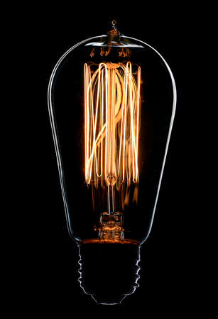 electricity supply: Light bulb on black background Stock Photo
