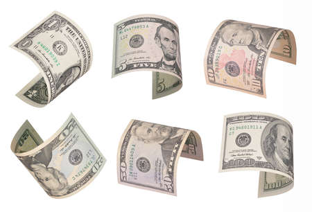 ben franklin money: Set of flying dollar bills. Isolated on white