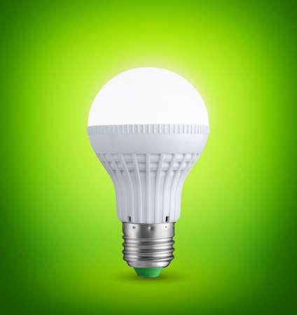 e27: Glowing LED bulb on green background