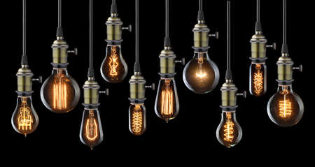 Collection of vintage glowing light bulbs on black