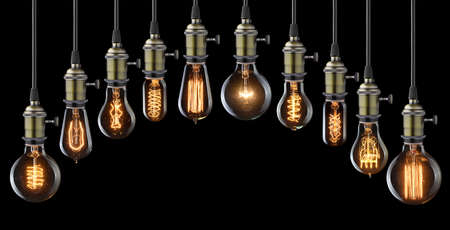 innovation concept: Set of vintage glowing light bulbs on black