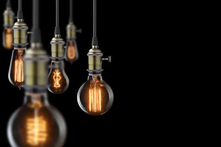vintage glowing light bulbs on black background
