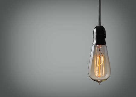 Vintage hanging light bulb over gray background Banco de Imagens - 48880672