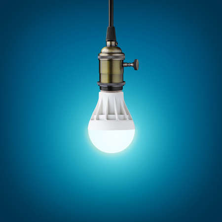 bright ideas: Glowinng LED bulb on blue background