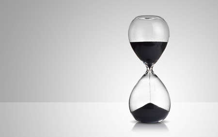 hourglass on gray background Stock Photo - 49134528
