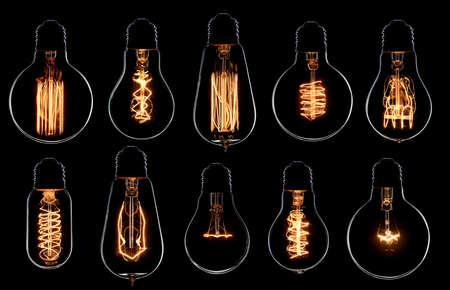 electric bulb: Glowing vintage light bulbs set. Black background