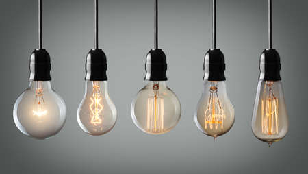 Vintage hanging light bulbs over gray background