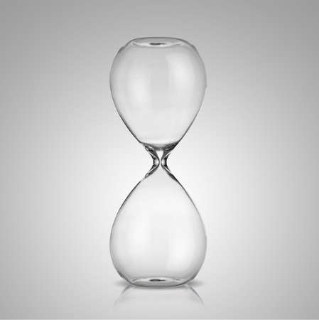 trickle: Empty hourglass on gray background