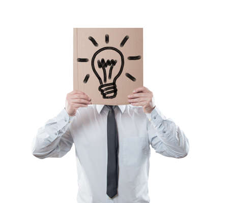 cowardice: Big idea concept. Businessman holding a cardboard on white background. Clipping path