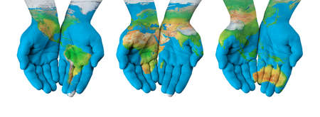 World map painted on hands isolated Foto de archivo