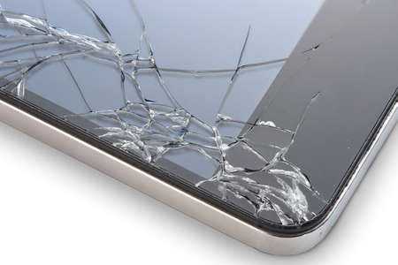 mobile phones: Macro photo of an cell phone with broken display isolated on white Stock Photo