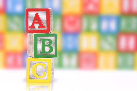 ABC blocks on a colorful blurred background