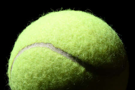 item: Tennis ball isolated on black background Stock Photo
