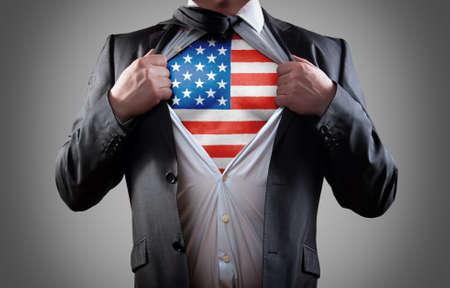 politics: Businessman superhero with the American flag shirt