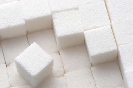 sweeten: close up of white sugar cubes Stock Photo