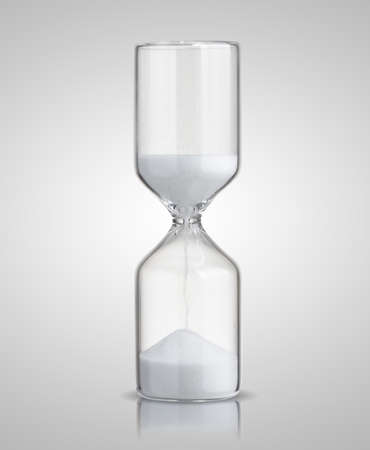 trickling: hourglass isolated on gray background Stock Photo