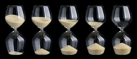 age 5: Set of hourglasses isolated on black background Stock Photo