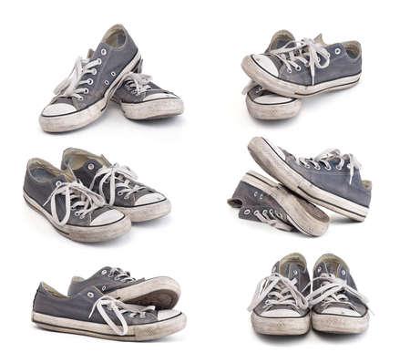 chaussure: Ensemble de vieilles baskets sales isolé sur fond blanc