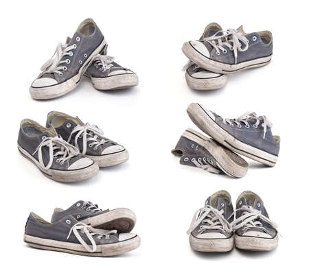 old shoes: Set of old dirty sneakers isolated on white background Stock Photo