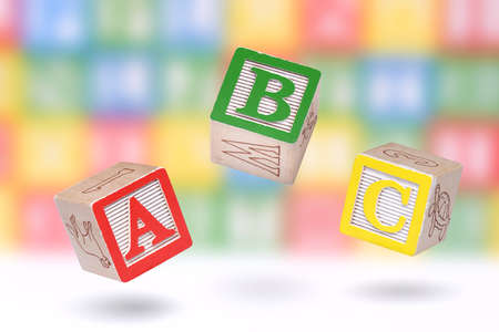 abc blocks: ABC blocks on a colorful blurred background