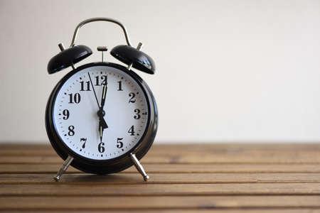 awake: Vintage alarm clock on wooden table Stock Photo