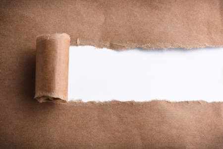 paper curl: Brown paper torn to reveal white panel Stock Photo