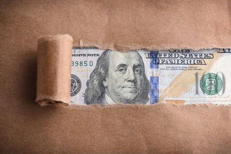 benjamin: Benjamin Franklin macro through torn paper