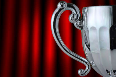Closeup silver trophy cup on gray background