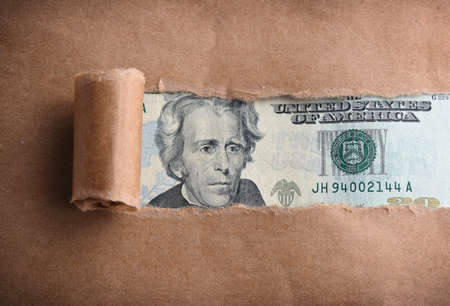torn: Twenty dollars macro through torn paper Stock Photo