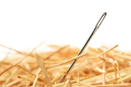 Closeup of a needle in haystack. Isolted on white background
