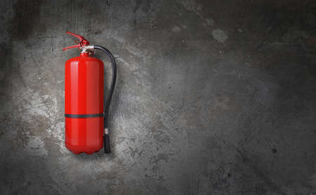 fire extinguisher on gray wall